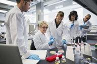 Science professor explaining scientific experiment to students laboratory - HEROF27726