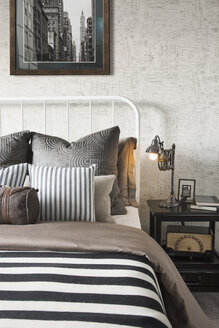 Striped and patterned pillows and blanket on bed - HEROF27756