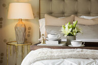 Tea tray and flowers on elegant bed - HEROF27759