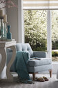 Turquoise decor and armchair by window - HEROF27762