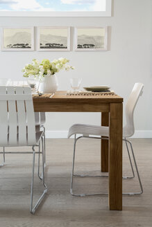 White chairs at wooden dining table - HEROF27771