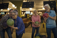 Friends bowling at bowling alley - HEROF27951