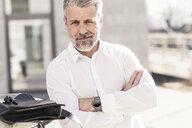 Portrait of confident mature businessman outdoors - UUF16610