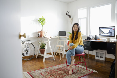 Portrait confident young woman working in home office - HEROF28002