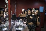 Bachelorette and friends taking selfie in nightclub bathroom - HEROF28116