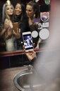 Bachelorette and friends taking selfie in nightclub bathroom mirror - HEROF28119