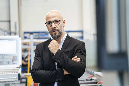 Portrait of serious businessman in a factory - DIGF06085