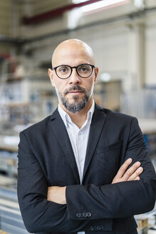 Portrait of confident businessman in factory - DIGF06160