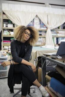 Portrait confident female fashion designer in studio - HEROF28206