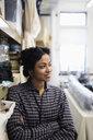 Portrait confident female fashion designer in studio - HEROF28212