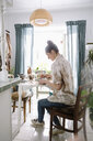 Female artist working at dining table - HEROF28299