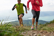 Joggers in Annecy, Rhone-Alpes, France - CUF49558