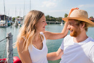 Young couple on sailboat on Chiemsee lakeside, Bavaria, Germany - CUF49633