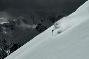 Male skier speeding down steep mountainside, Alpe-d'Huez, Rhone-Alpes, France - CUF49675