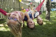 Portrait upside-down kids hammock backyard birthday party - HEROF28396