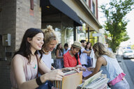 Women browsing records at sidewalk sale - HEROF28465