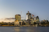 UK, London, City of London, River Thames, skyline with modern office buildings at sunset - MKFF00450