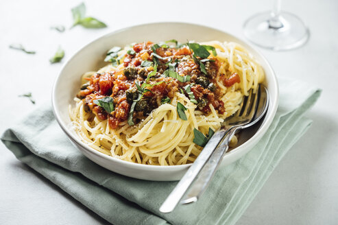 Spaghetti with tomato caper sauce, basil and parmesan with a glass of red wine - IPF00506