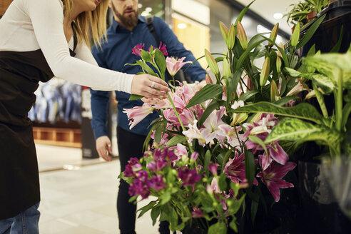 Florist taking flower in flower shop - ZEDF01964
