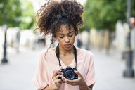 Young woman looking at camera in the city - JSMF00862