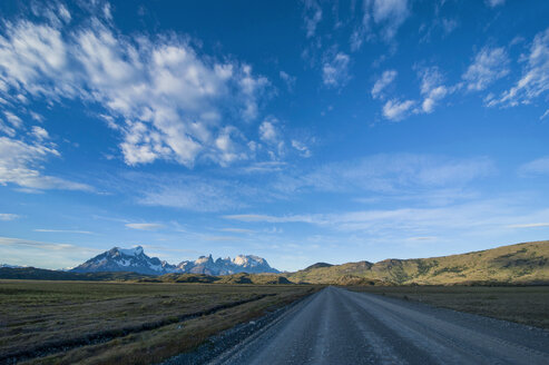 Chile, Patagonia, Straight road leading through the Torres del Paine National Park - RUNF01488