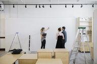 Art gallery owners preparing space - HEROF28635
