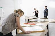 Female gallery owner framing print - HEROF28644