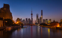 Waibaidu bridge over Huangpu river with Pudong skyline at night, Shanghai, China - CUF49825