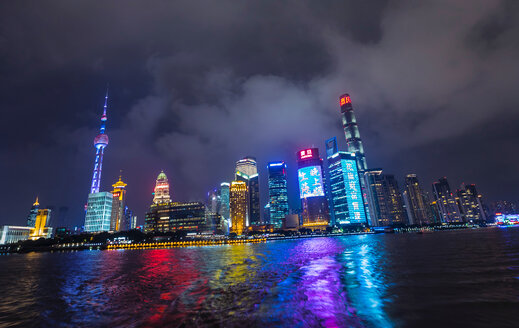 Pudong skyline with Oriental Pearl Tower at night, view from star ferry, Shanghai, China - CUF49837