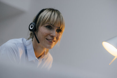 Businesswoman having a conference call with headset - JOSF03255