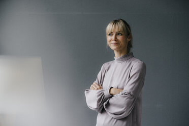 Portrait of a confident blond woman with arms crossed - JOSF03258