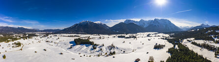 Germany, Bavaria, Alps and Karwendel mountains, Mittenwald, snowy meadow, aerial view - AMF06834