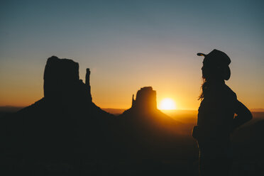 USA, Utah, Monument Valley, silhouette of  woman with cowboy hat watching sunrise - GEMF02888
