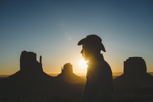 USA, Utah, Monument Valley, silhouette of man with cowboy hat at sunrise - GEMF02894