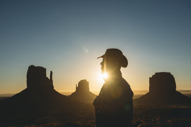 USA, Utah, Monument Valley, silhouette of man with cowboy hat at sunrise - GEMF02897