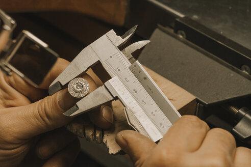 Artisan making jewellery, fixing ring - AHSF00024