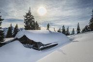 Germany, Chiemgau, Rauschberg, Inzell Kienberg, skier on wooden hut - HAMF00567