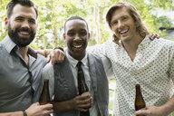 Portrait smiling men drinking beer - HEROF28736
