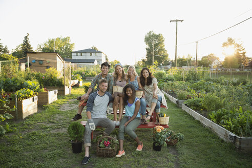 Portrait smiling friends in community garden - HEROF28751