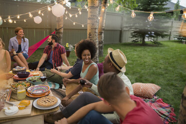 Friends enjoying backyard dinner party - HEROF28832