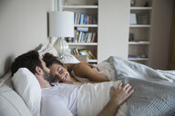 Affectionate couple cuddling in bed - HEROF28904