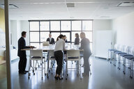 Business people standing in conference room meeting - HEROF28922
