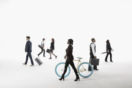 Business people commuting and traveling against white background - HEROF29195