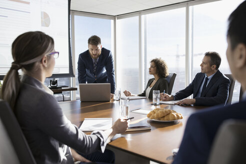 Businessman leading presentation in conference room meeting - HEROF29279