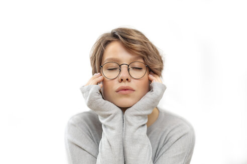 Portrait of young woman with glasses and eyes closed - VGF00230
