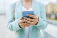 Close-up of woman's hands with smartphone - KIJF02420