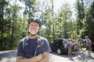 Portrait smiling senior man wearing mountain biking helmet - HEROF29451