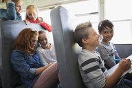 School kids riding school bus - HEROF29529