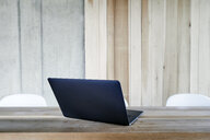 Laptop on wooden table - FMKF05432