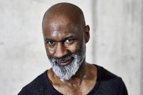 Portrait of smiling sweating mature man - FMKF05513